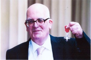 Harold Alderman displays his M.B.E.
